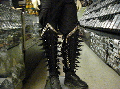 (GOATMOON)...giant black spiked leather shin guards.(MDLSG0180)